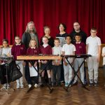 Members of MCng, MFG abd baboro pose with children - classical music concerts galway